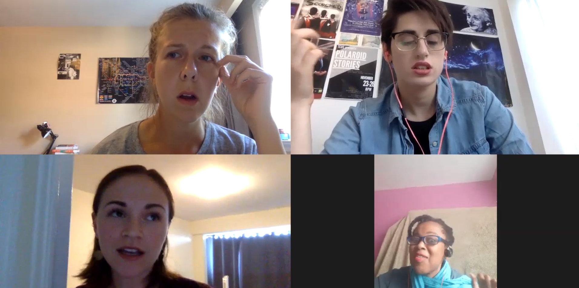 """Four people in a Zoom meeting during a performance of """"Pandemic Roommates"""". One person is in the middle of speaking, while the others are looking off in different directions."""